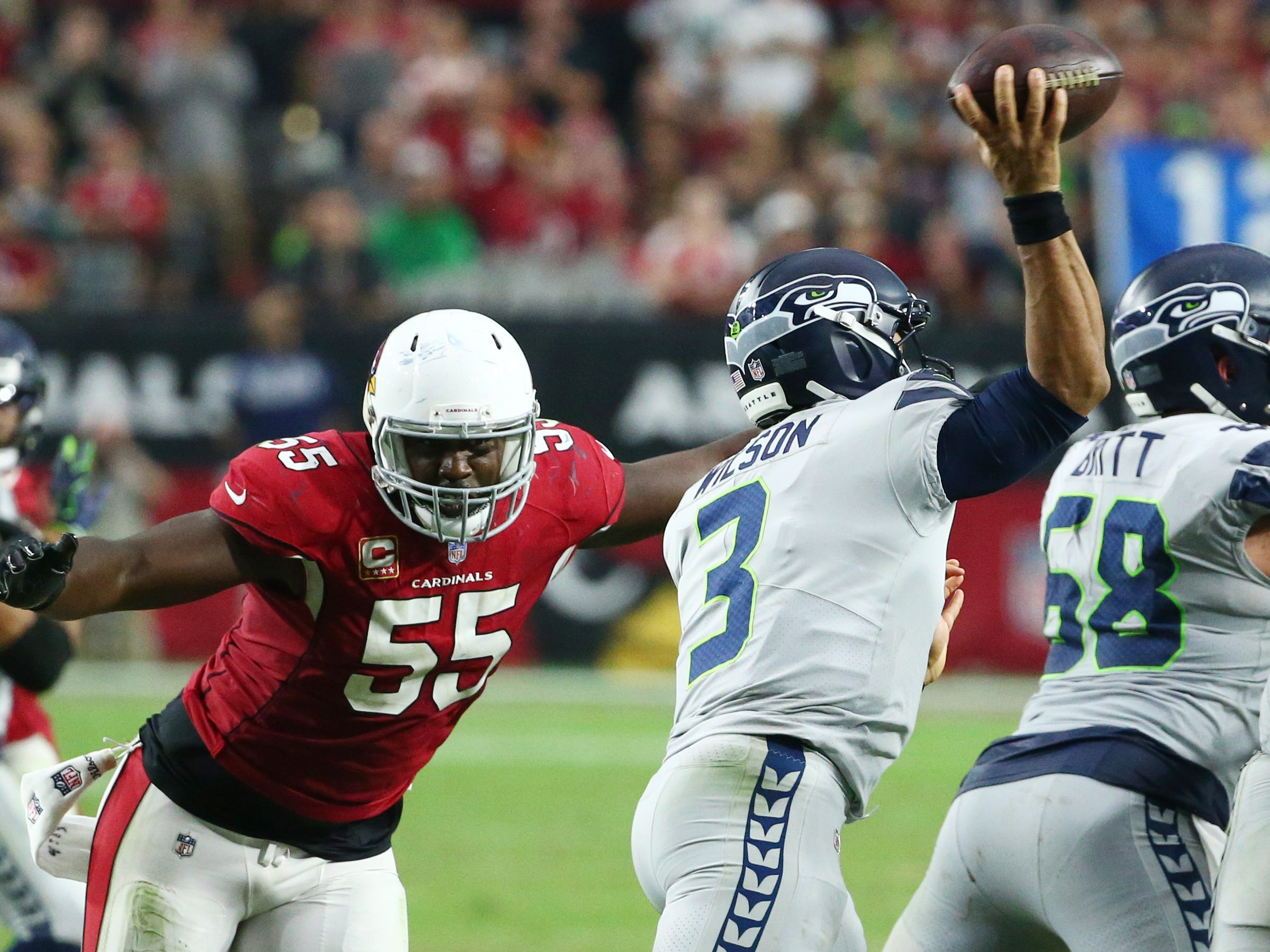 Arizona Cardinals linebacker Chandler Jones pressures Seattle Seahawks quarterback Russell Wilson in the first half at State Farm Stadium in Glendale, Ariz.