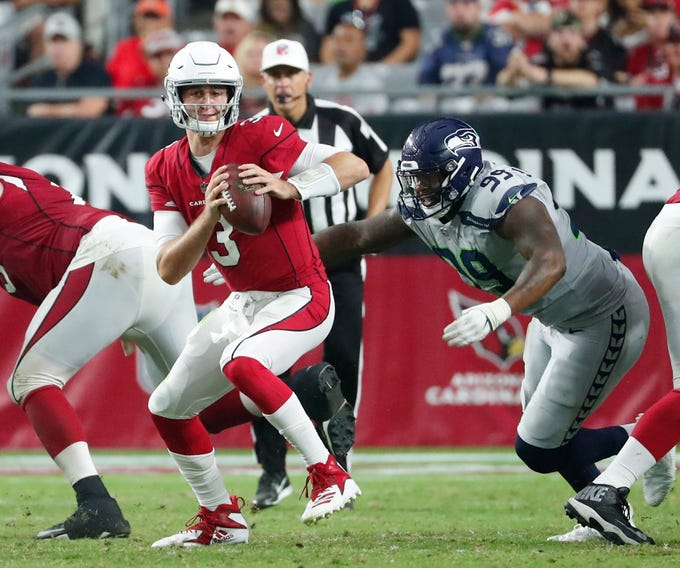 Arizona Cardinals quarterback Josh Rosen (3) scrambles away from Seattle Seahawks defensive tackle Quinton Jefferson (99) during the third quarter at State Farm Stadium in Glendale, Ariz. September 30, 2018.