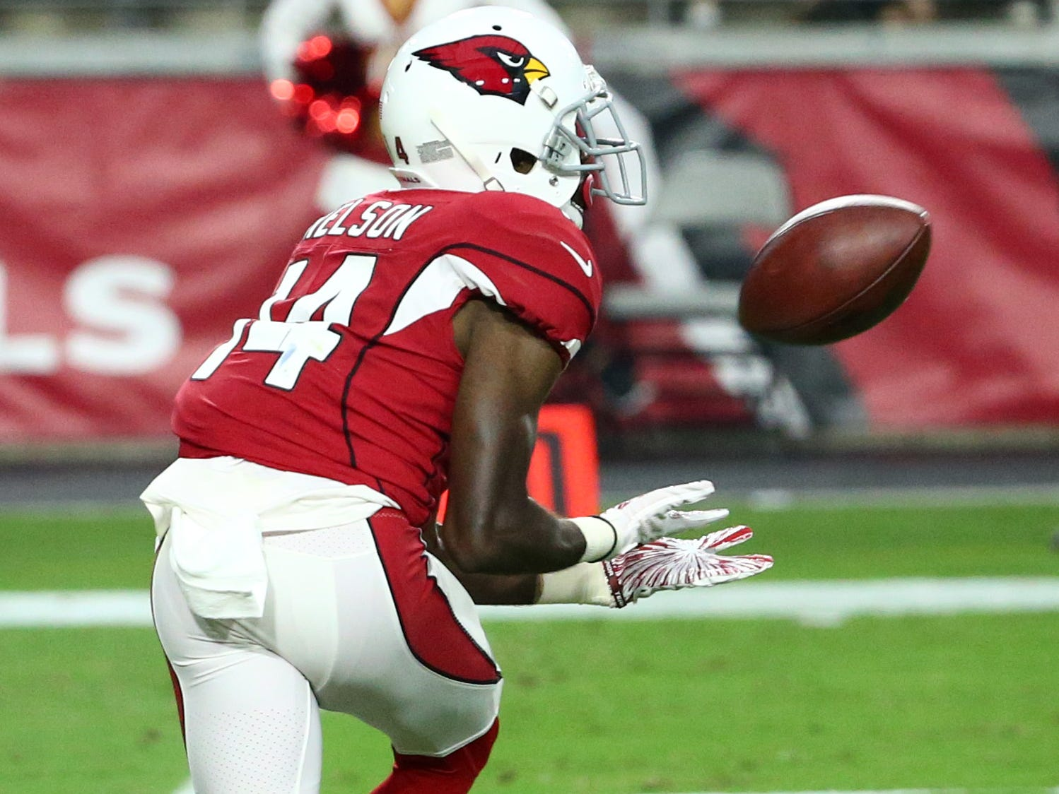 Arizona Cardinals wide receiver J.J. Nelson misses a wide-open pass against the Seattle Seahawks in the first half at State Farm Stadium in Glendale,  Ariz.