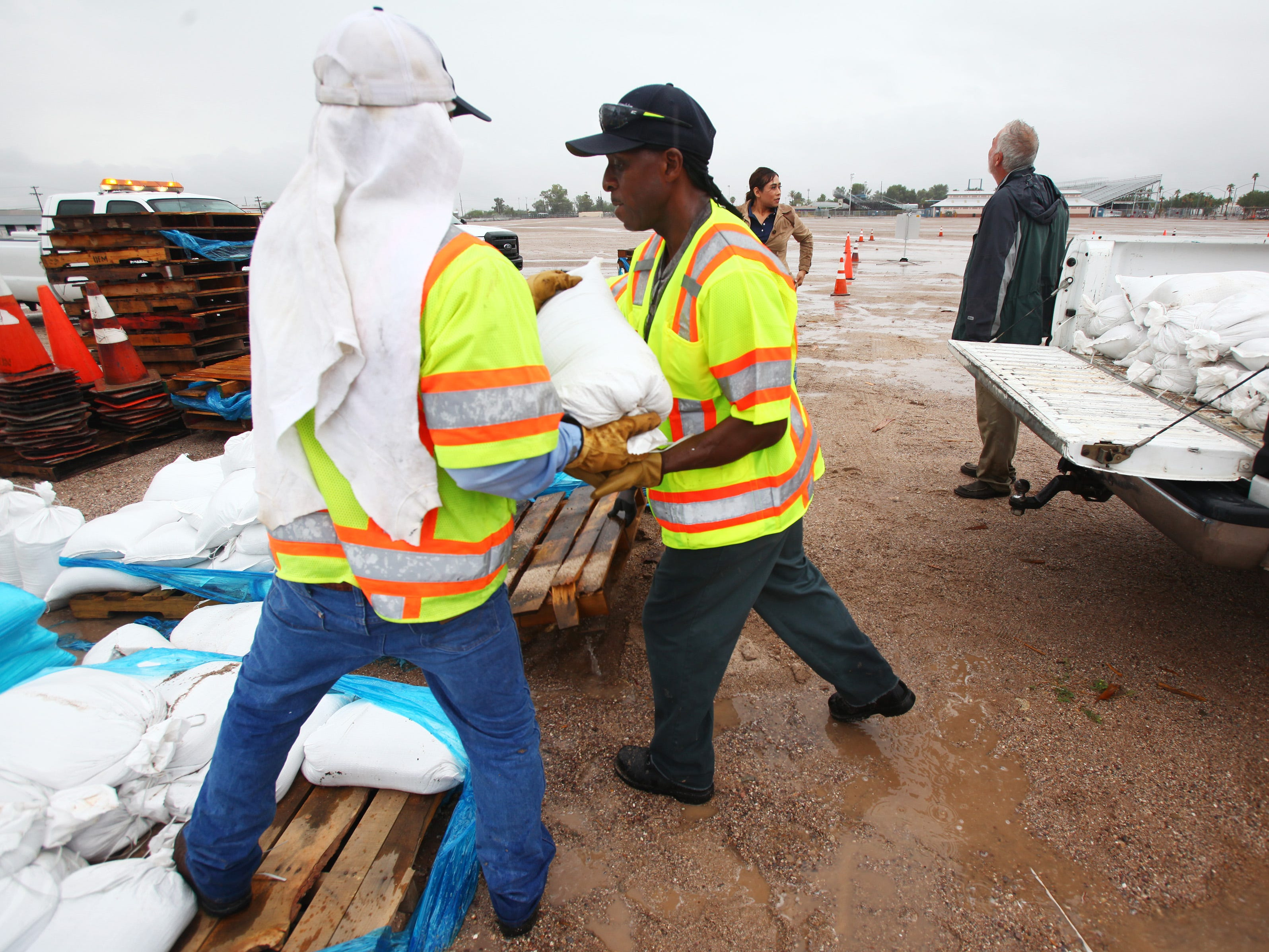 Workers from the Tucson Department of Transportation load sandbags for residents during rain from the remnants of Hurricane Rosa in Tucson on Oct. 1, 2018.