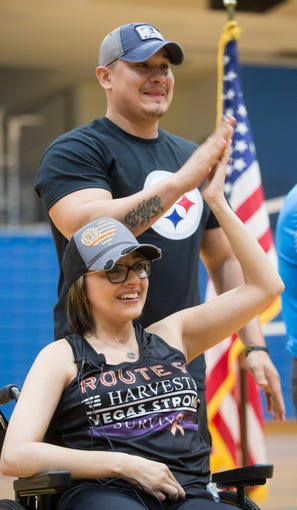 Jovanna Calzadillas and her husband Frank Calzadillas clap during an assembly at Hayden High School to honor Calzadillas who was wounded in the Route 91 Harvest Festival shooting.