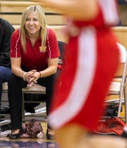 Tiffany Tate, assistant coach with the Seton High School girls basketball team,  watches from the bench during a 2010 game against Basha at Mesquite High School.