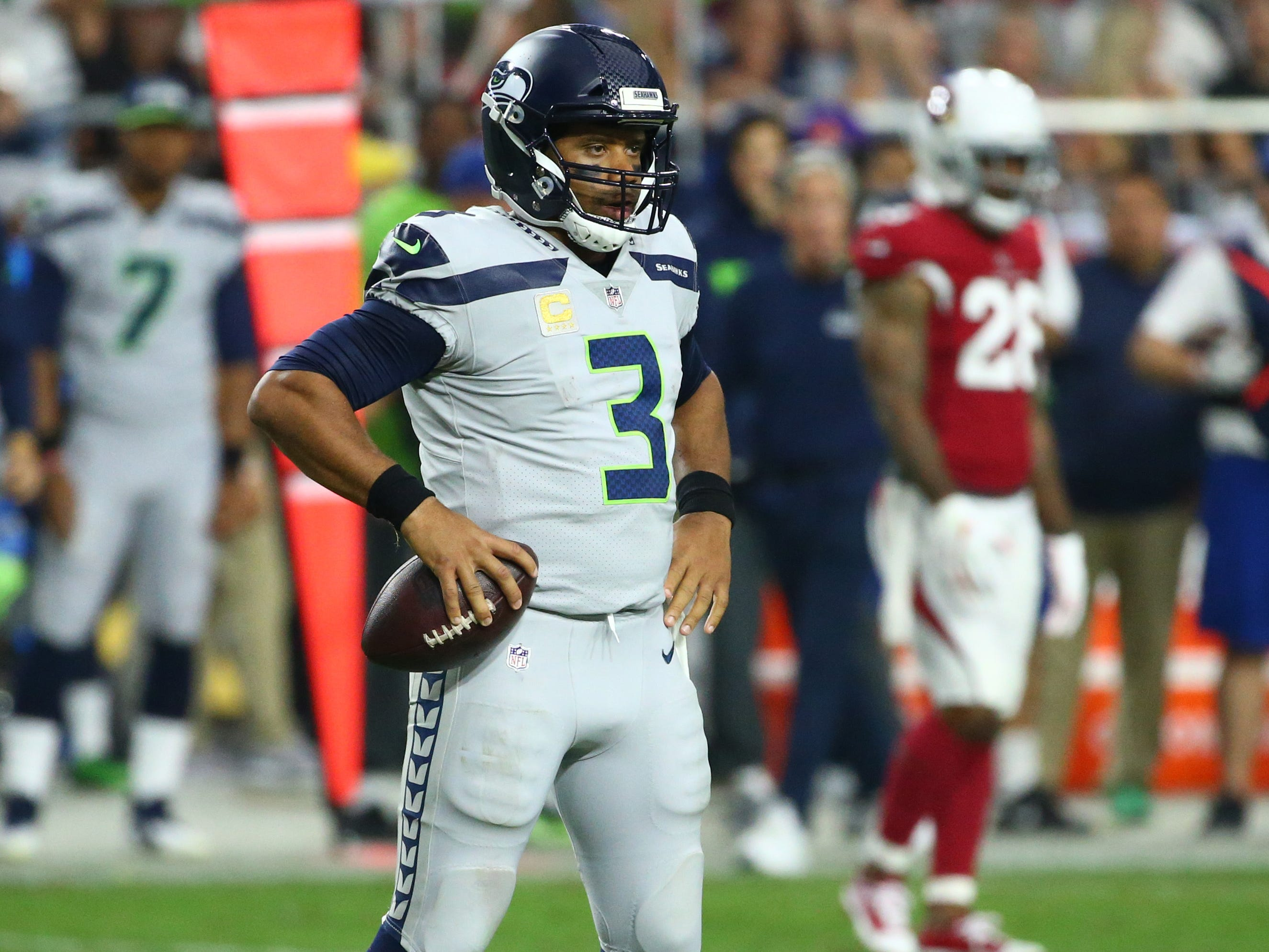 Seattle Seahawks Russell Wilson against the Arizona Cardinals in the second half at State Farm Stadium in Glendale, Ariz.
