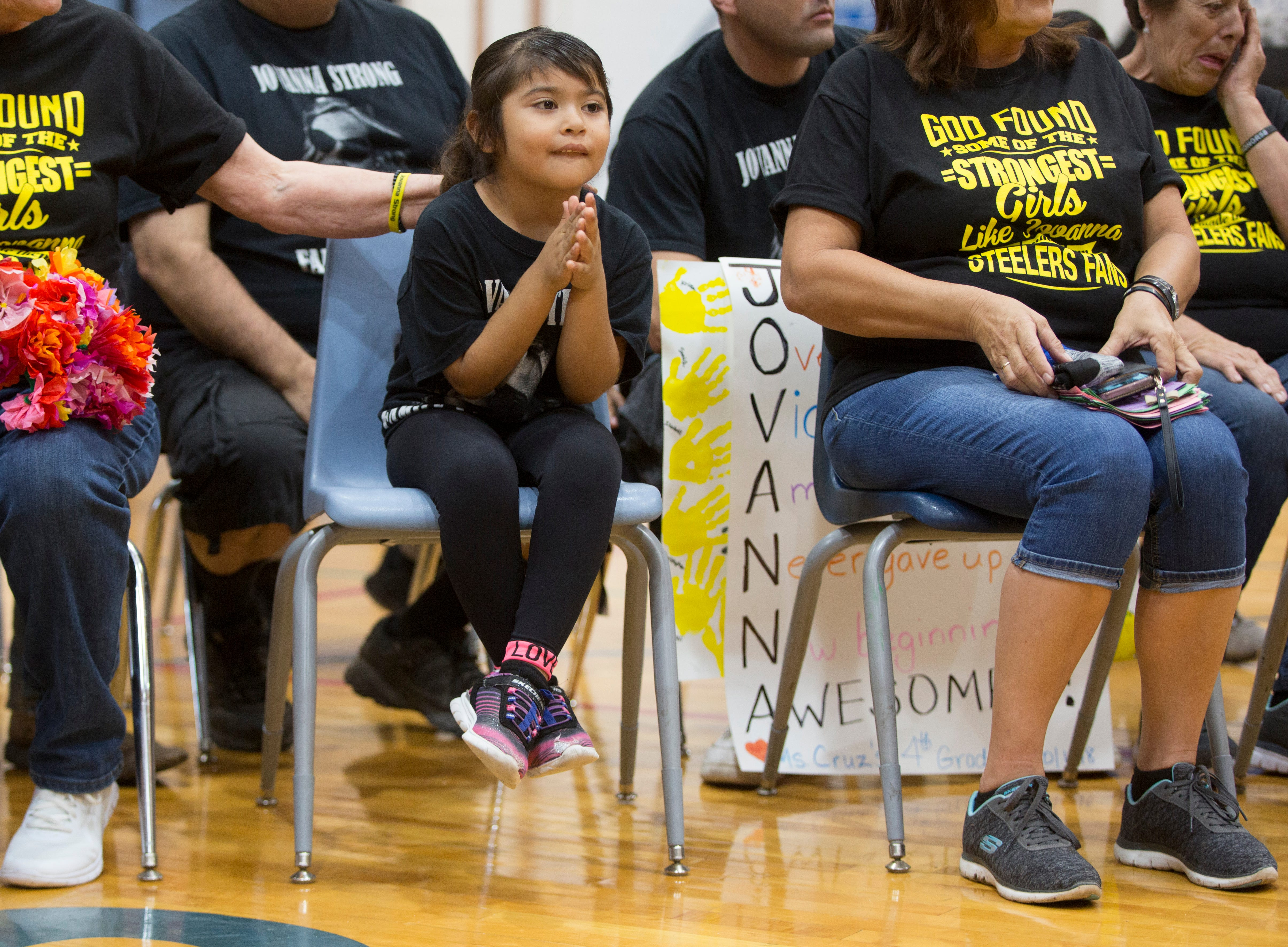 Yarili Aguro, 4, claps during an assembly for her cousin Jovanna Calzadillas who was severely wounded during a mass shooting at the Route 91 Harvest Festival in Las Vegas. The Calzadillas family spent the day with friends and family in Winkleman.
