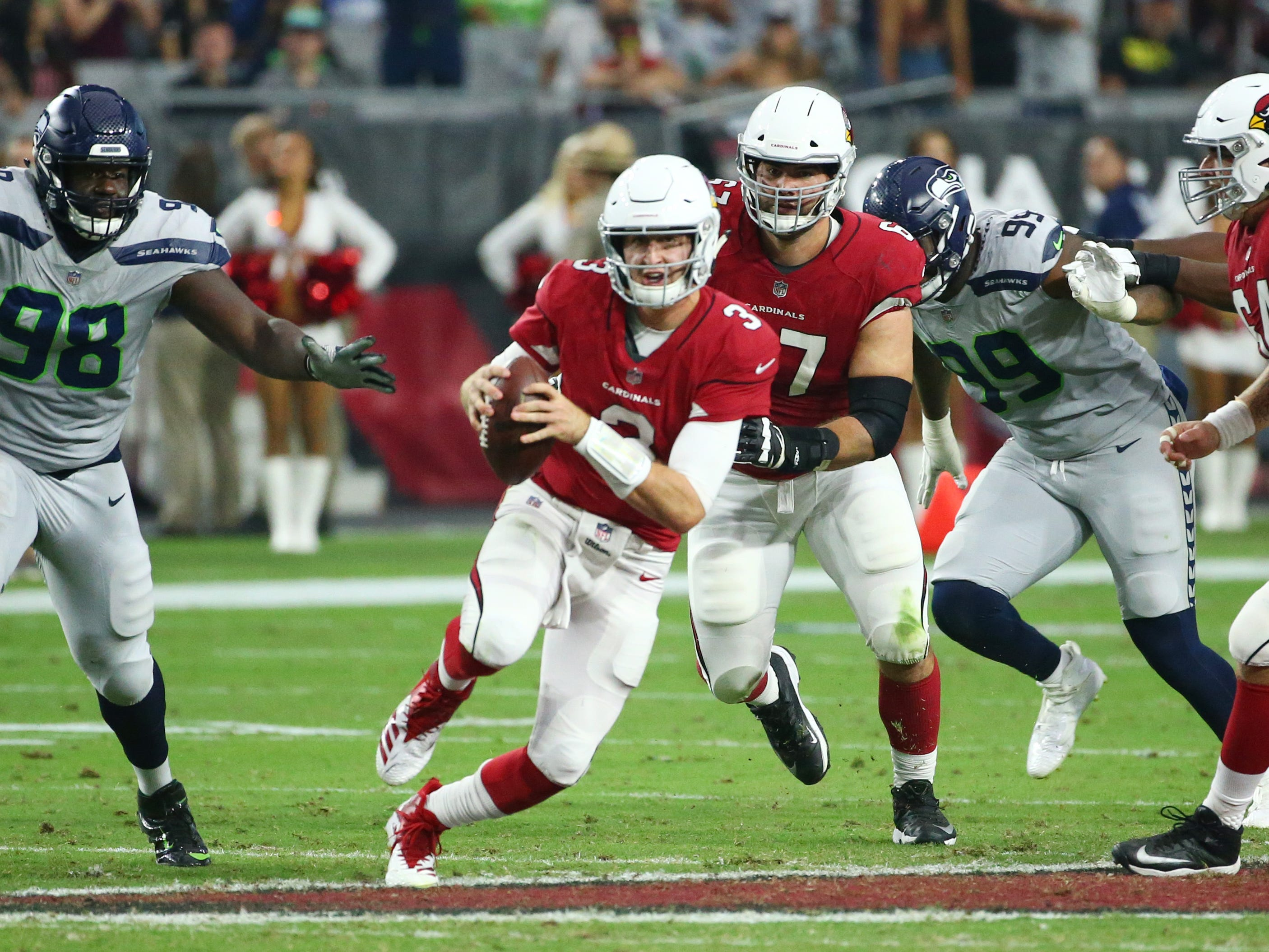 Arizona Cardinals quarterback Josh Rosin runs with the ball against the Seattle Seahawks in the first half at State Farm Stadium in Glendale, Ariz.