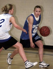 Chandler basketball player Tiffany Tate works out during a 2001 practice.