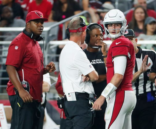 Arizona Cardinals quarterback Josh Rosen (3) talks with (from left) quarterbacks coach Byron Leftwich, offensive coordinator Mike McCoy and head coach Steve Wilks during a break against the Seattle Seahawks in the second quarter at State Farm Stadium in Glendale, Ariz. September 30, 2018.