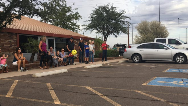 Family members waited on Sept. 30 outside Phoenix Fire Department Special Operations for the members of Arizona Task Force 1 to return from the east coast.