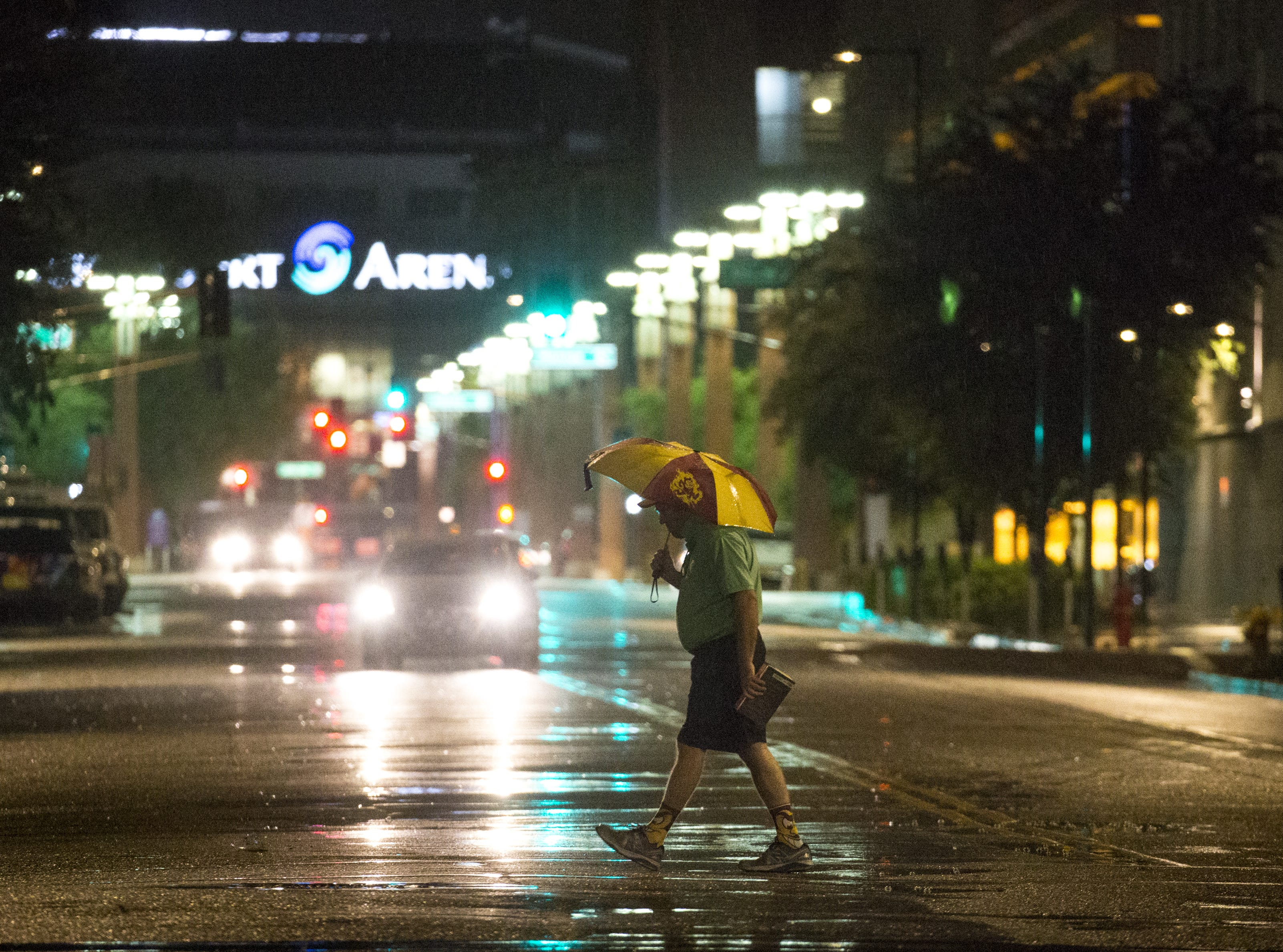 A pedestrian crosses Third Street in downtown Phoenix on Sept. 30, 2018.