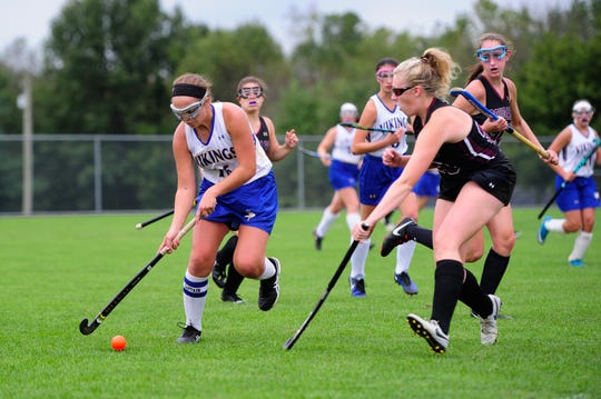 Carrie Shuey, left, of the Northern Lebanon field hockey team