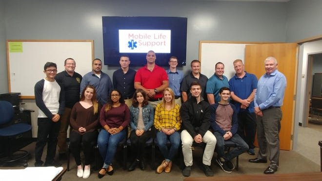 Mobile Life Support Services CEO and President, Scott Woebse (far right), welcomes 15 new EMTs and paramedics to its staff of approximately 500 medical professionals