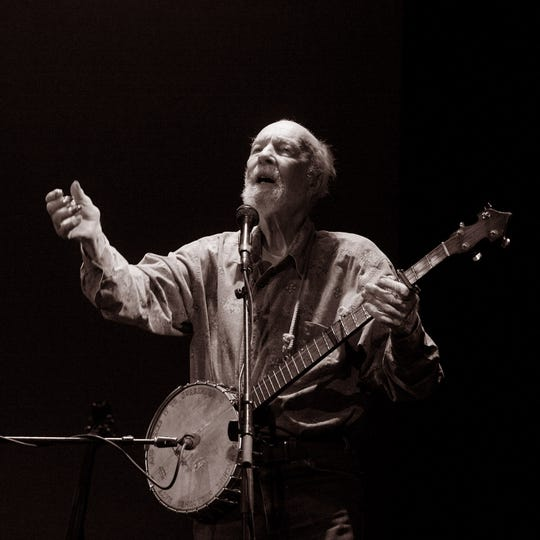 "The late Pete Seeger is shown at a 2008 concert in this photograph by Bibiana Huang Matheis, part of the ""American Roots Music"" exhibit at the Howland Cultural Center in Beacon."