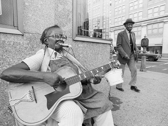 "Flora Molton performs in Washington D.C. (1980) in this photograph by Axel Küstner, part of the ""American Roots Music"" exhibit at the Howland Cultural Center in Beacon."