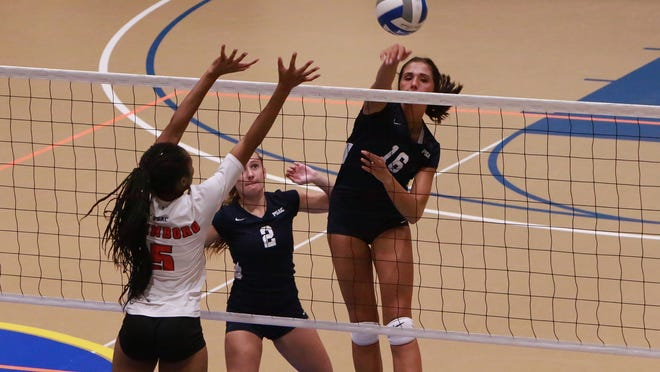 Caitlyn Vrabel goes up for the kill for Pitt-Johnstown.