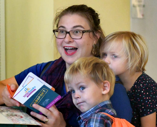 """Ellie Nowak of York City and her children Rosie, 4 and Anthony, 2, look over the kid's passports during York County Libraries' launch of the """"1000 Books Before Kindergarten"""" early childhood initiative program at Martin Library Monday, Oct. 1, 2018. During the free program,  families use a child's library-issued """"passport"""" from any York County library, to log reading milestones, with those reaching the 1000-book goal invited to a graduation ceremony next August. Bill Kalina photo"""