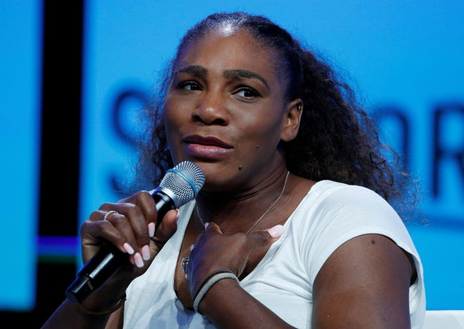 """FILE - In this Sept. 14, 2018, file photo, tennis star Serena Williams speaks in Las Vegas. Serena Williams goes topless and sings """"I Touch Myself"""" in a video to promote breast cancer awareness month. With her hands covering her breasts, Williams writes in the Instagram post that the video took her out of her """"comfort zone."""" But she said she wanted to do it because early detection saves so many lives. (AP Photo/John Locher, File)"""