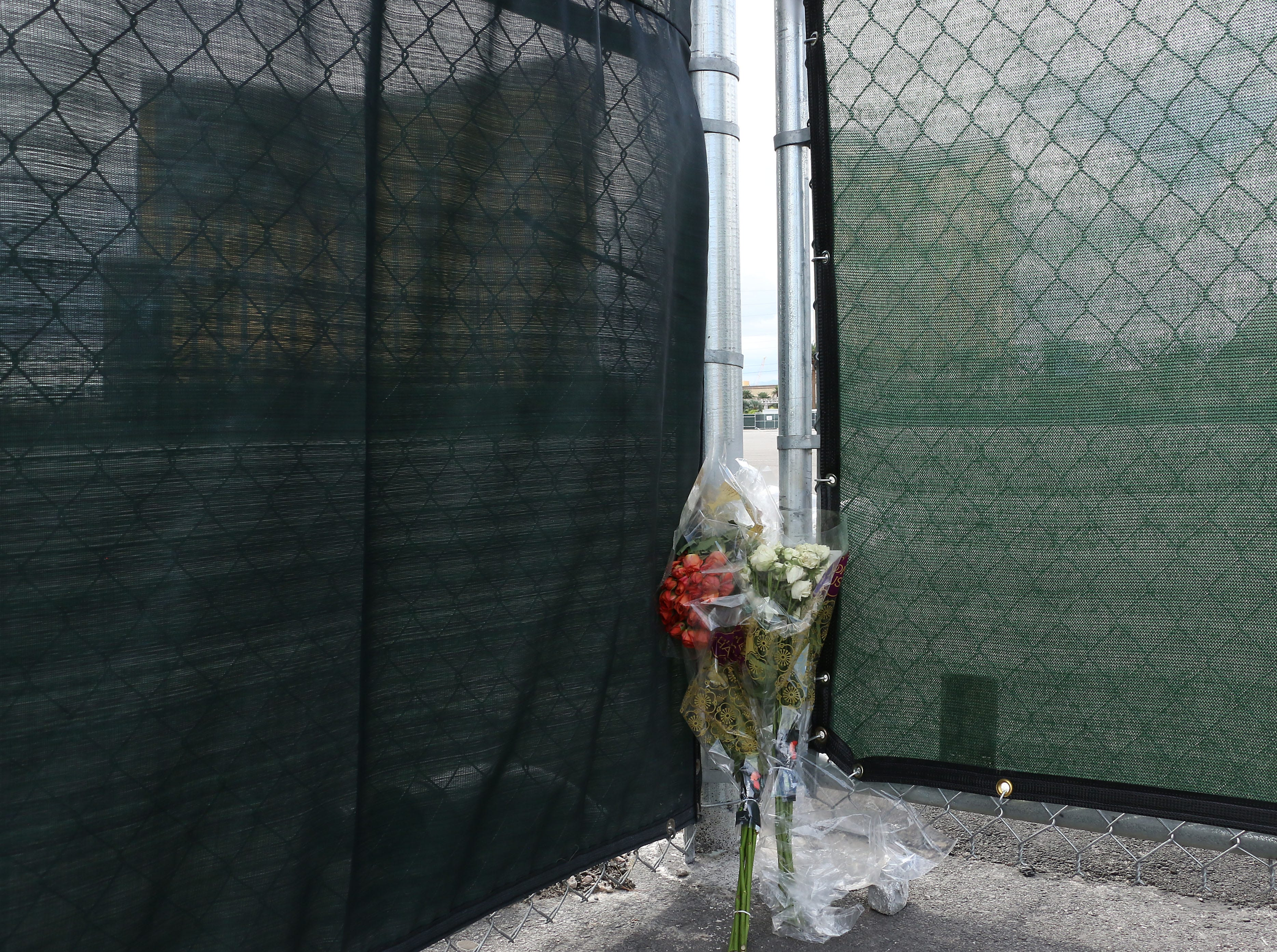 Flowers are seen next to the Route 91 Harvest Festival concert grounds as Las Vegas remembers the mass shooting one year later on Oct. 1, 2018.