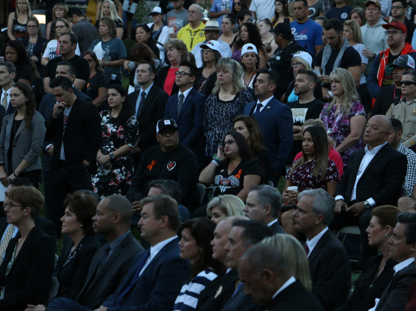 People gather for the 1 October Sunrise Remembrance at the Clark County Government Center Amphitheater in Las Vegas on Oct. 1, 2018.  The ceremony marked the one year anniversary of the mass shooting in Las Vegas.