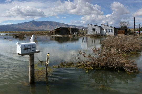 A swollen Swan Lake encroaches on private properties in Lemmon Valley on Sept. 14.