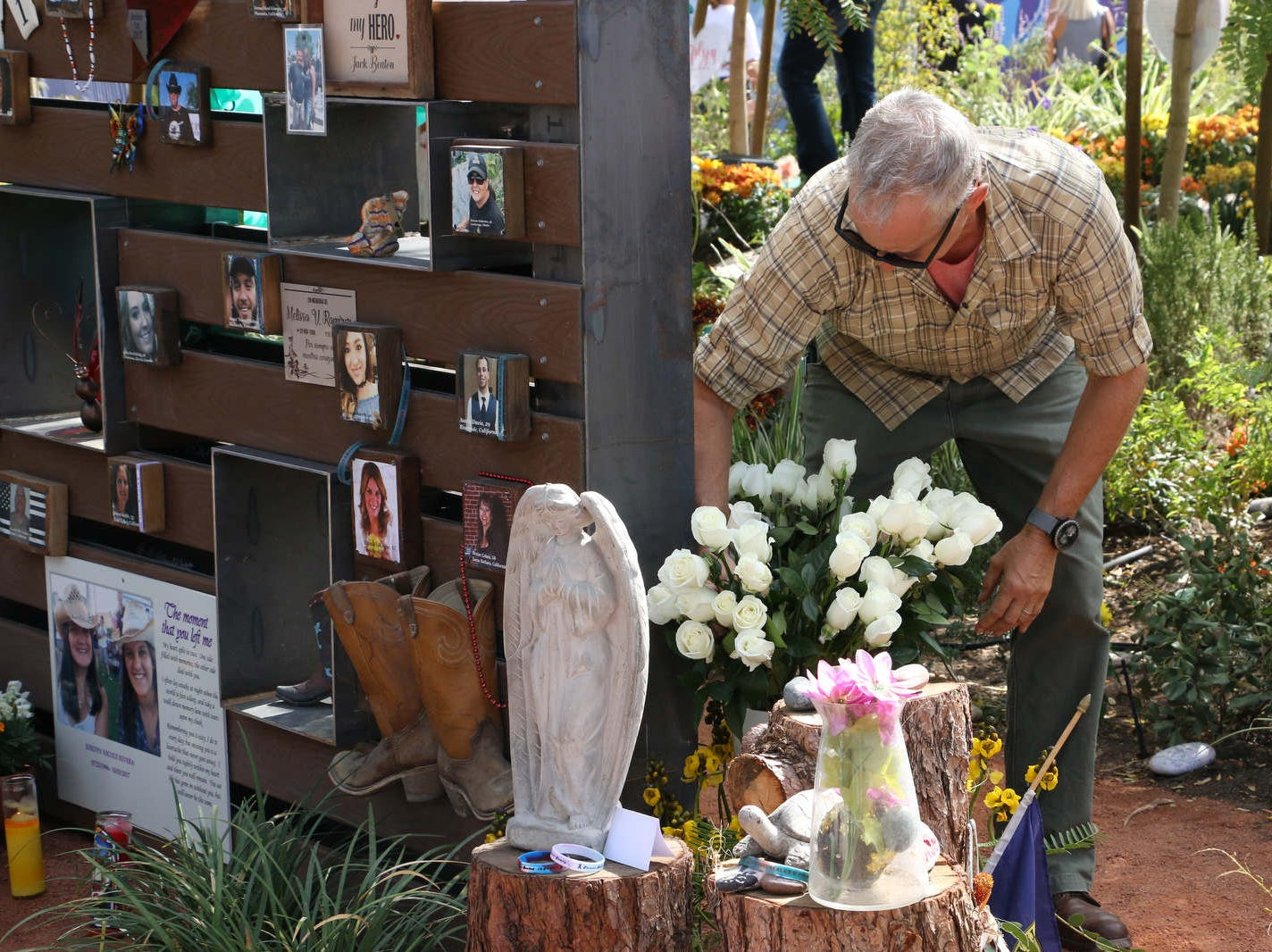 Las Vegas remembers the mass shooting one year later on Oct. 1, 2018.  People gather to pay their respects at the Las Vegas Healing Garden.