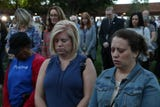 People observe a minute of silence for the victims of the Las Vegas shooting during a remembrance ceremony on Oct. 1, 2018.