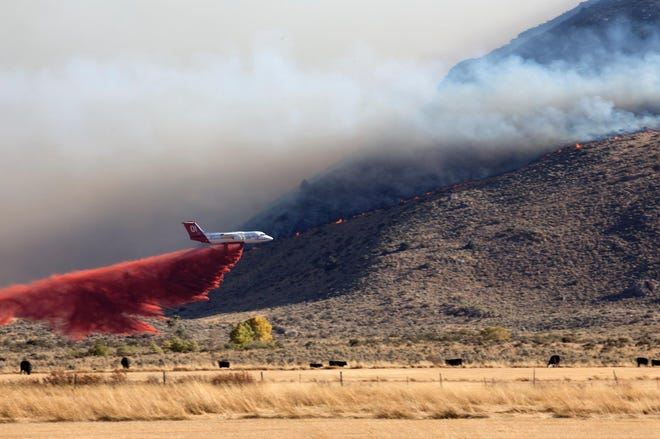 An air tanker drops retardant ahead of the Range 2 Fire burning in the Ruby Mountains on Sunday, Sept. 30.