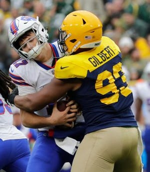 Green Bay Packers linebacker Reggie Gilbert (93) sacks Buffalo Bills quarterback Josh Allen (17) in the third quarter of last Sunday's game at Lambeau Field in Green Bay, Wisconsin.