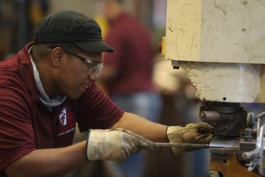 Edwin Feliz working at Steel Tech Fabricators in Rochester.