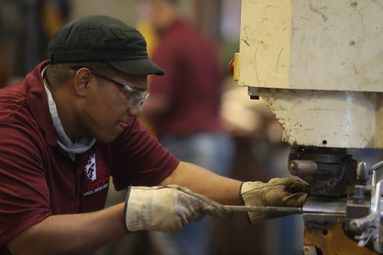 Edwin Feliz working at Steel Tech Fabricators in Rochester.