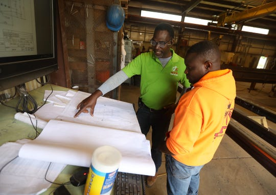 Terence Brown Sr. and Joseph E. Nelson discuss a project.