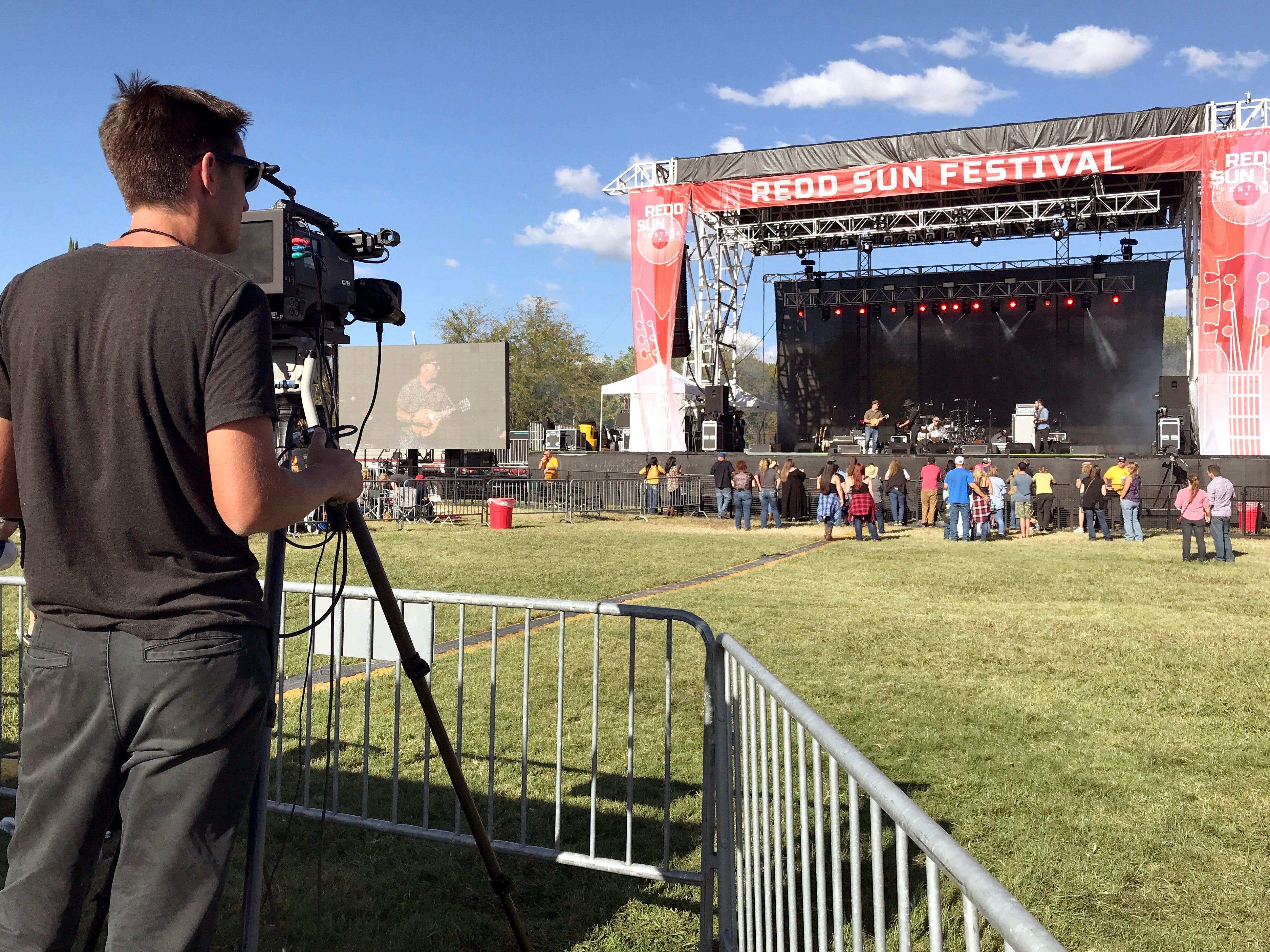 A cameraman films David Luning and his band Sunday afternoon during the Redd Sun Festival.