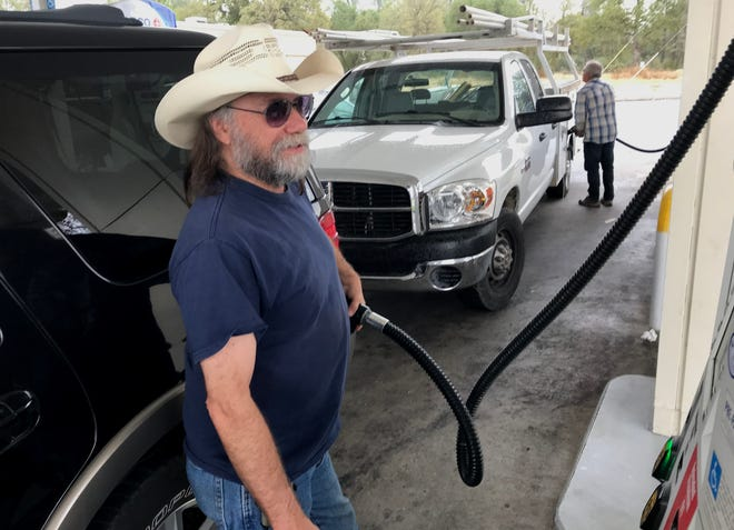 Greg Deptuch, a retired long-haul truck driver, pumps gas into his sport utility vehicle at a Redding gas station. Like many, Deptuch is tired of California's high taxes.