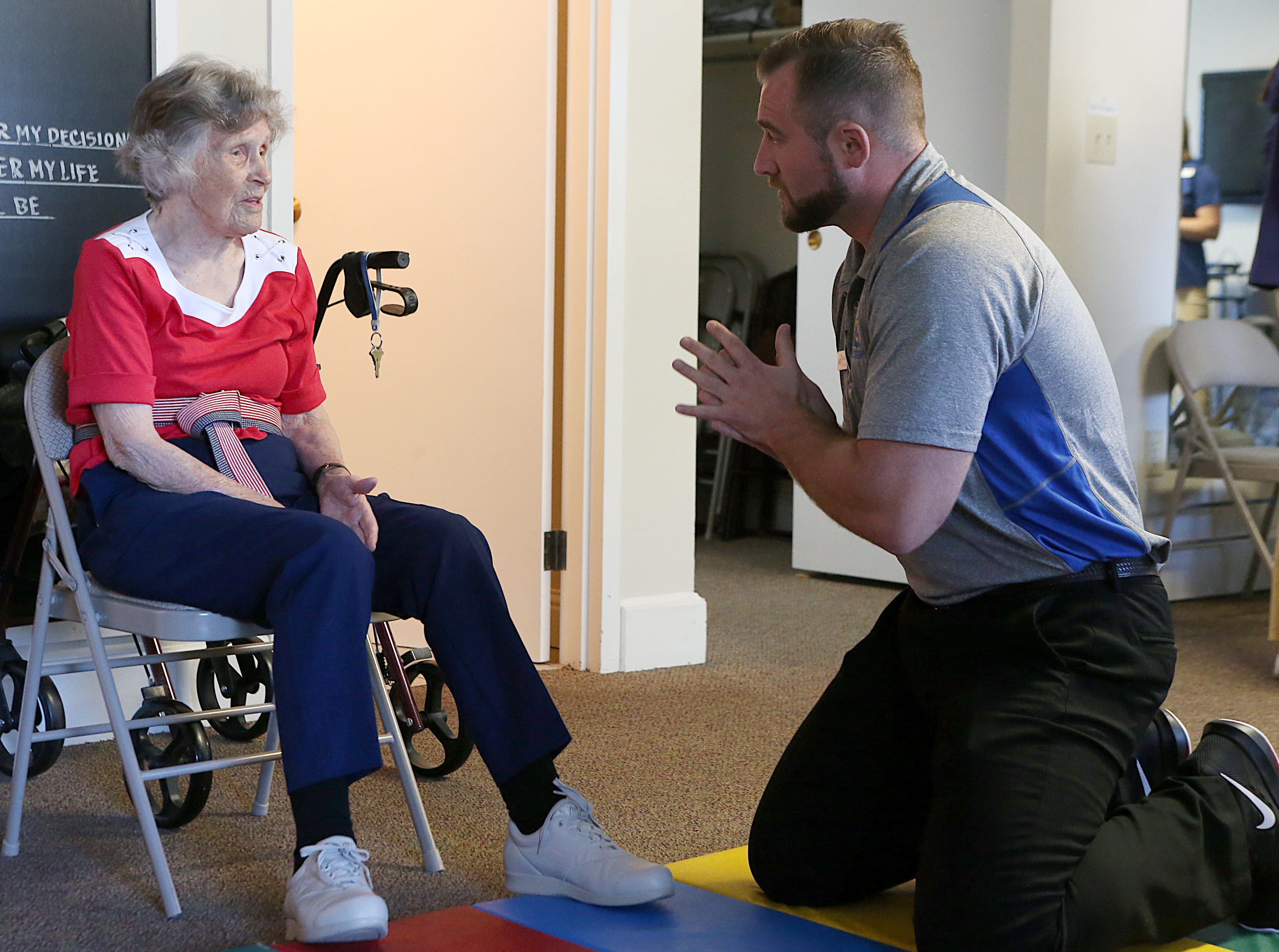 Residents Barbara Marshal talks with Dan Grimes, a physical therapy student from Angelo State University, during a Balance and Fall Risk Reduction Program for seniors at Baptist Retirement Community Monday, Oct. 1, 2018.