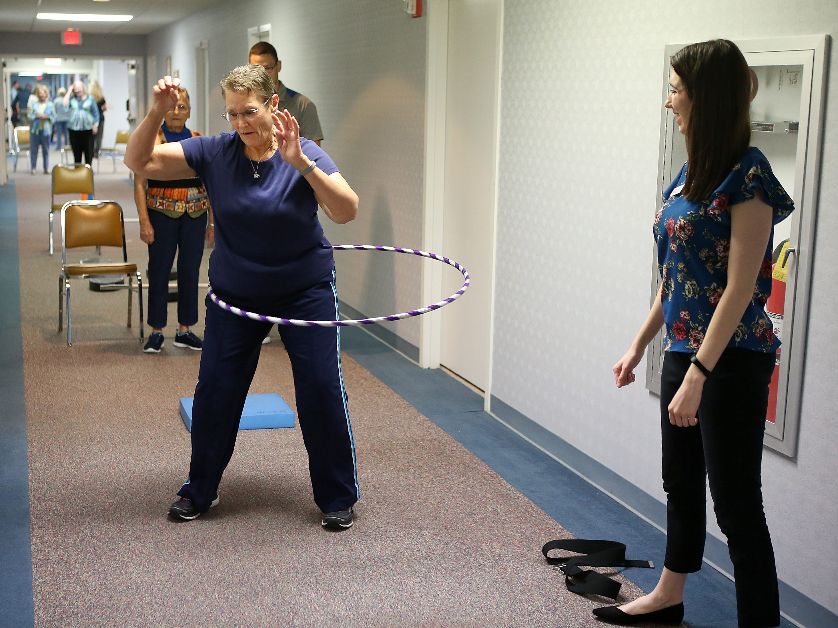 Resident Francis Evans participate in an activity designed by Angelo State University physical therapy students during a Balance and Fall Risk Reduction Program for seniors at Baptist Retirement Community Monday, Oct. 1, 2018.