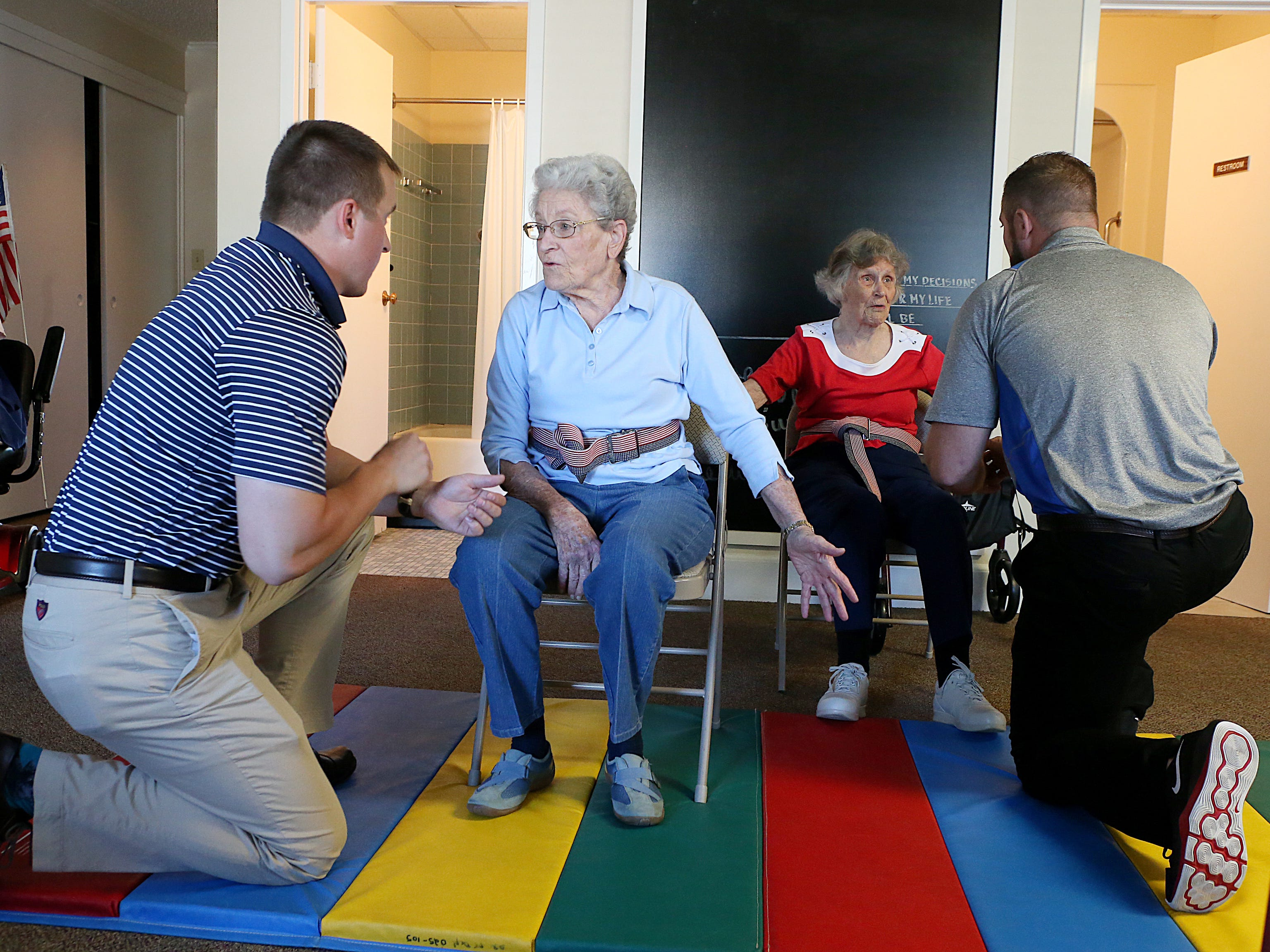 Residents June Heck (left) and Barbara Marshal talk with Angelo State University physical therapy students about what to do after falling down during a a Balance and Fall Risk Reduction Program for seniors at Baptist Retirement Community Monday, Oct. 1, 2018.