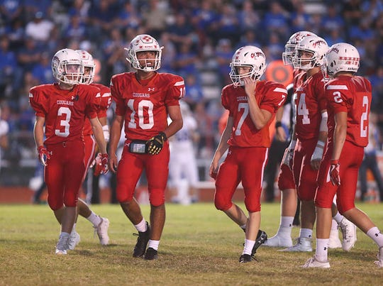 The Christoval Cougars walk off the field during a timeout during Friday night's game in Chistoval, Sept. 28, 2018.