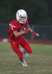 Christoval's Clayton Edmiston makes a play downfield during Friday nights game in Chistoval, Sept. 28, 2018.