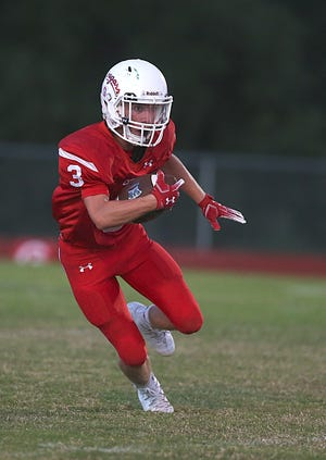 Christoval's Clayton Edmiston makes a play downfield during Friday night's game in Chistoval, Sept. 28, 2018.