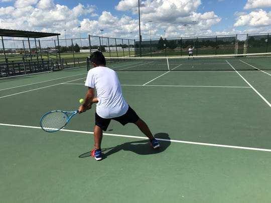 Lake View's Erick Torres, foreground, hits to doubles partner Francisco Mendoza during practice recently at the Brandon Clark Tennis Facility.