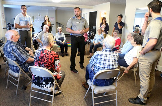 Angelo State University physical therapy student Dan Grimes talks with residents during a Balance and Fall Risk Reduction Program for seniors at Baptist Retirement Community Monday, Oct. 1, 2018.