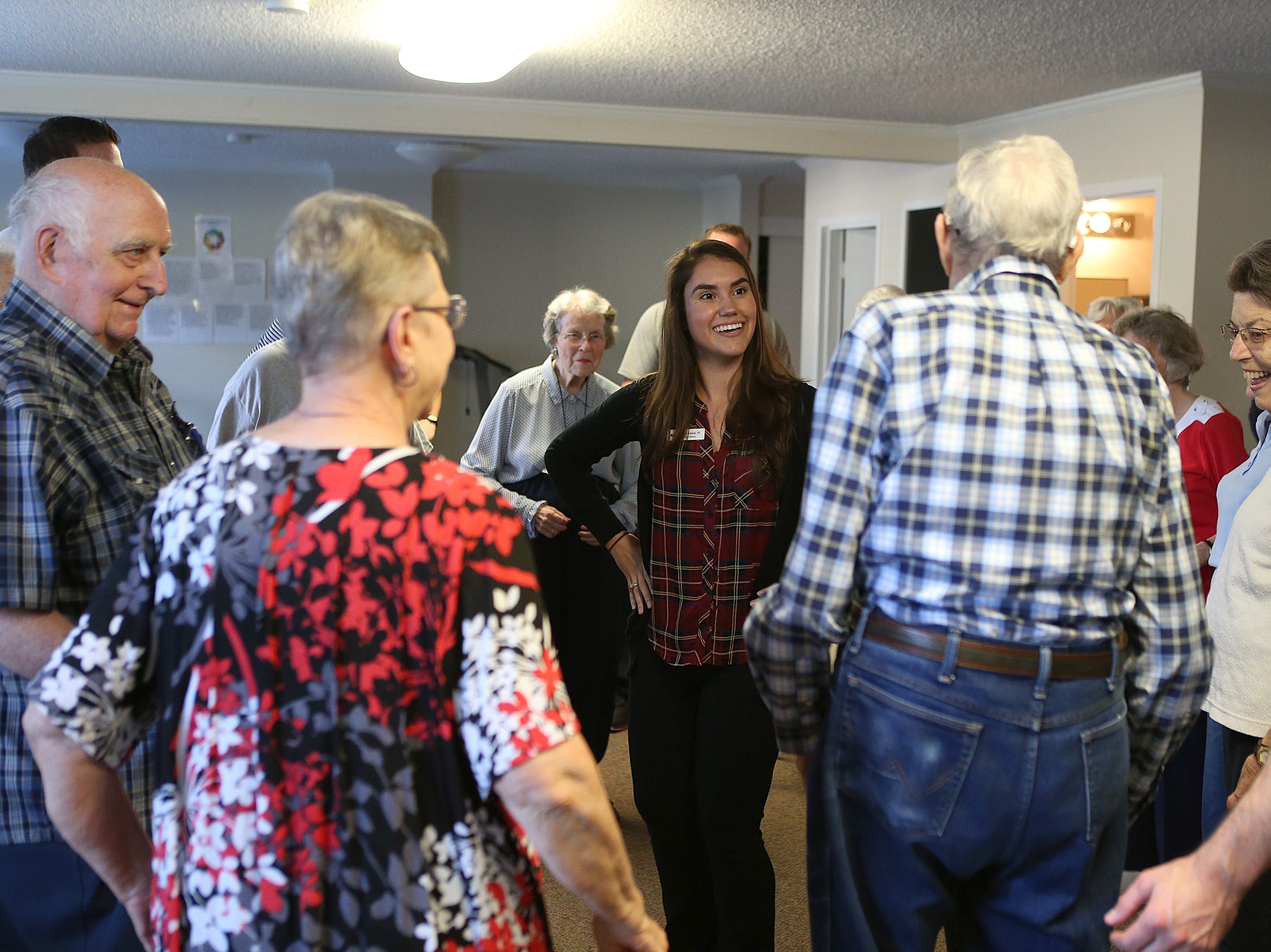 Natalia Traverzo, a physical therapy student at Angelo State University, dances with residents during a Balance and Fall Risk Reduction Program for seniors at Baptist Retirement Community Monday, Oct. 1, 2018.