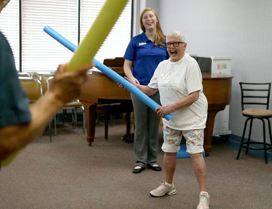 Resident Betty Green laughs while playing a balance game with fellow residents  during a Balance and Fall Risk Reduction Program for seniors at Baptist Retirement Community Monday, Oct. 1, 2018.