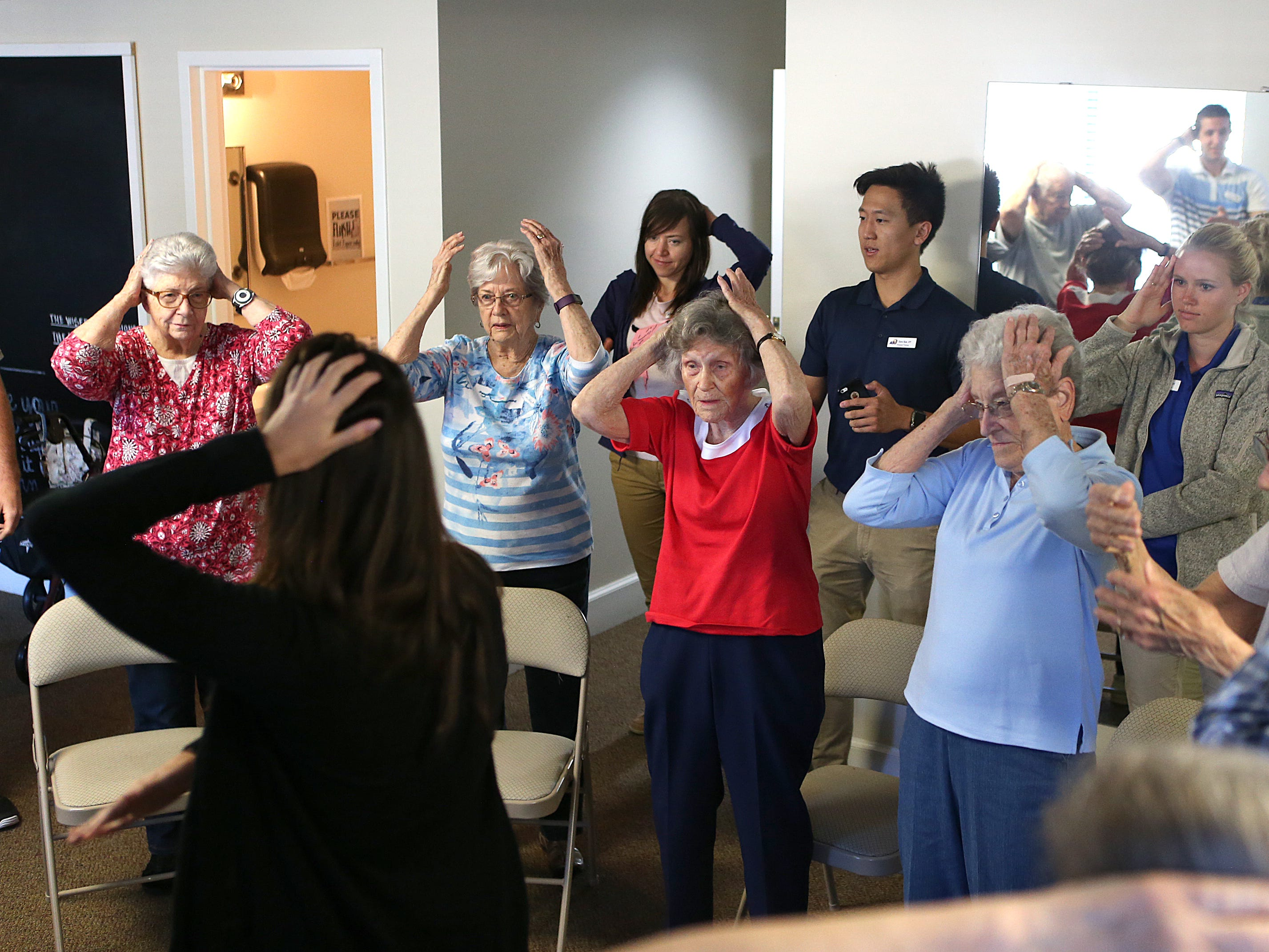 Residents participate in an activity designed by Angelo State University physical therapy students during a Balance and Fall Risk Reduction Program for seniors at Baptist Retirement Community Monday, Oct. 1, 2018.