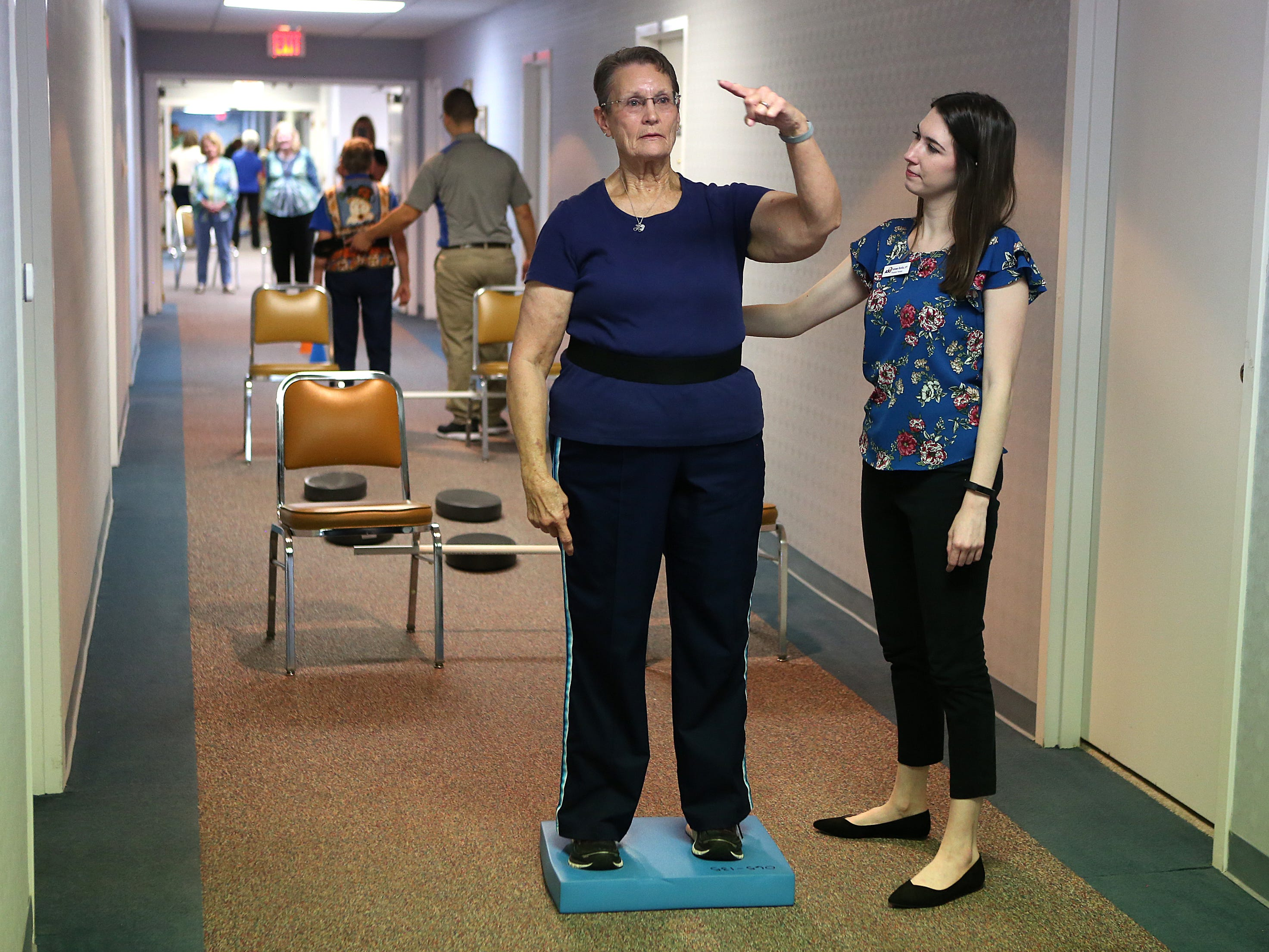 Autumn Hardin, a physical therapy student at Angelo State University, helps resident Francis Evans who participates in an activity designed by ASU physical therapy students during a Balance and Fall Risk Reduction Program for seniors at Baptist Retirement Community Monday, Oct. 1, 2018.