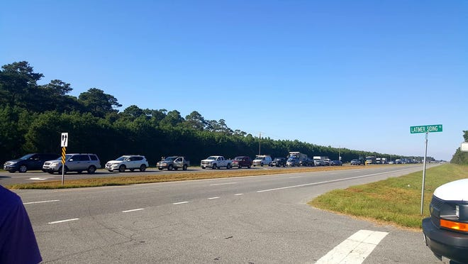 Vehicles waiting to cross the Chesapeake Bay Bridge-Tunnel line up on Route 13 on the Eastern Shore of Virginia on Monday, Oct. 1, 2018, after an incident in the Thimble Shoals Tunnel closed the span for hours.