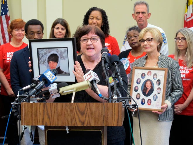Dorothy Paugh holds a photo of her son, Peter Lapa Lilly, during a news conference in Annapolis on Monday, Oct. 1 Lawmakers and gun-control advocates held the news conference to discuss a new law taking effect in Maryland that enables courts to temporarily restrict firearms access for people found to be a risk to themselves or others.