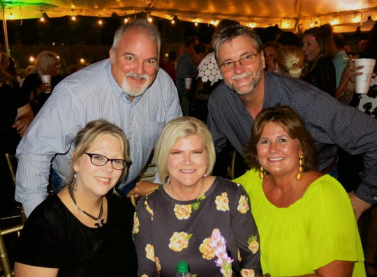 "Rene Davis (clockwise, from seated far right) Beverly Harris, Angie Hardey, Ron Davis, Byron Hardey at ""Celebration of Life."""