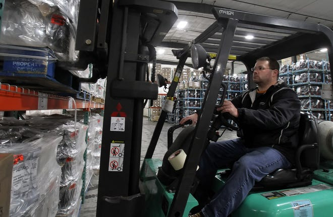An employee at Nordica Warehouses Inc., picks orders to be loaded and transported across the country.