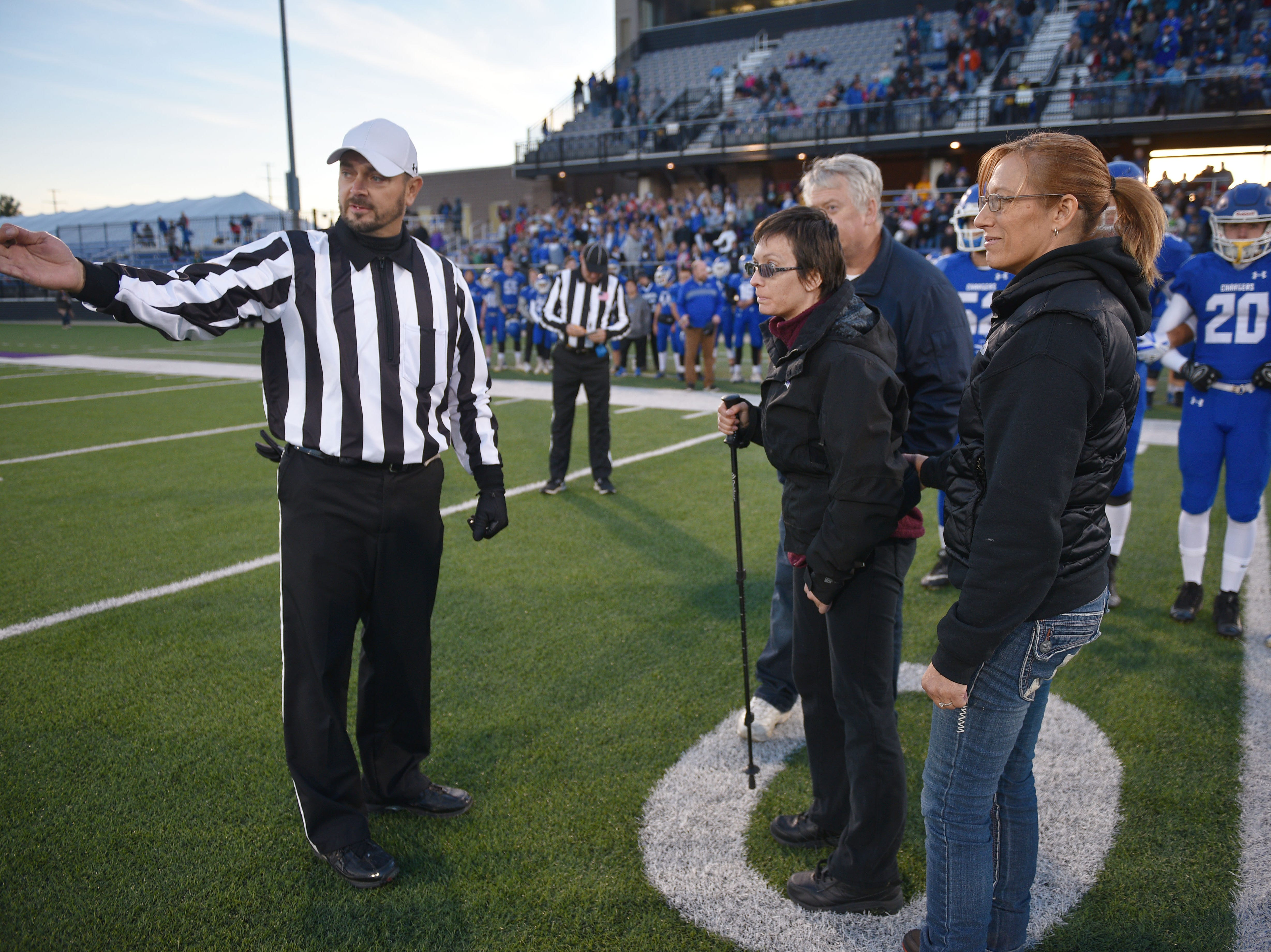 Referee Micheal Fuller gives instructions to Ashley Van Hemert for the coin toss for the Sioux Falls Christian game, Friday Sept. 28, at Bob Young Field University Of Sioux Falls Stadium.