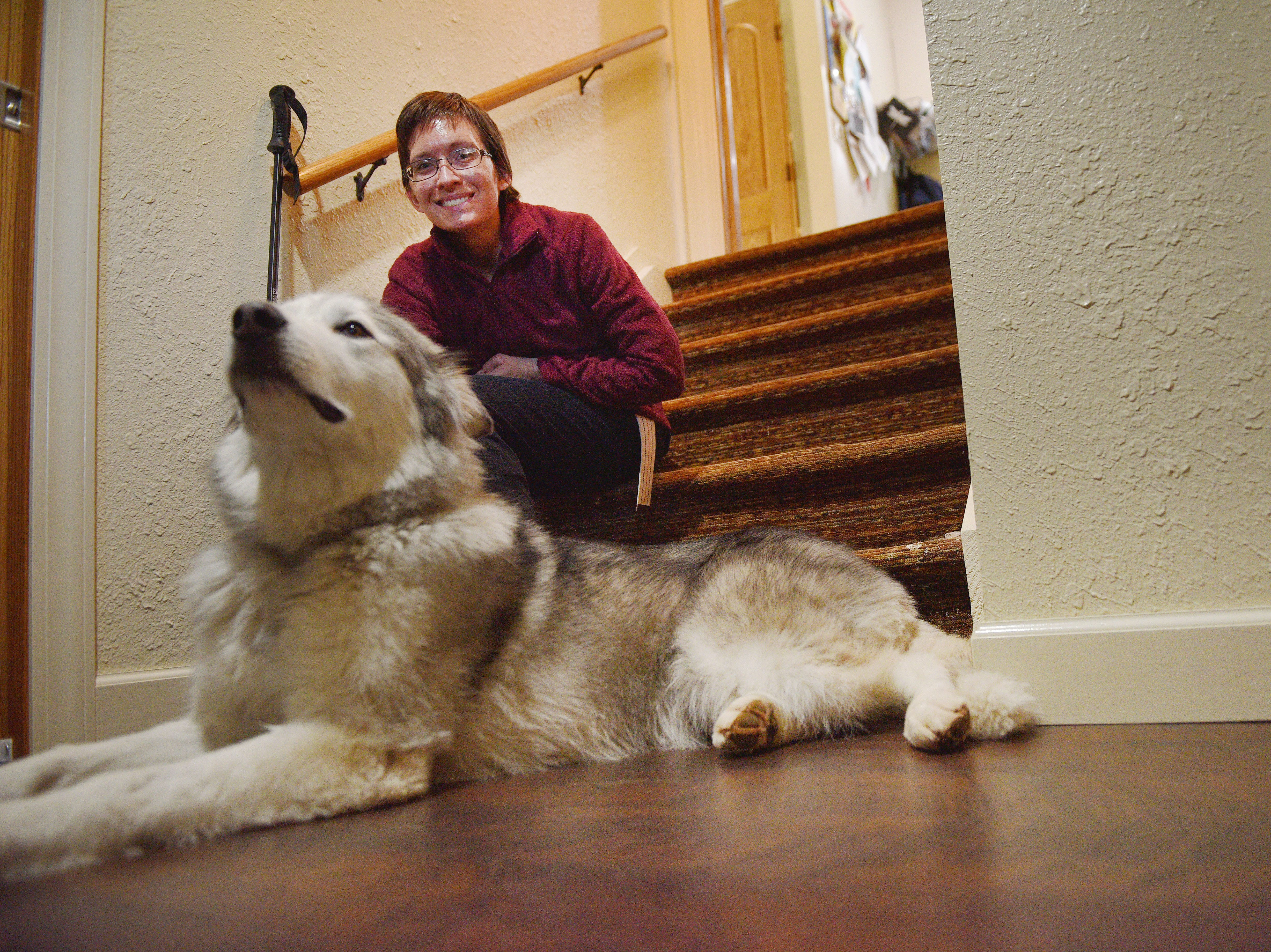 Ashley Van Hemert and her dog Bronson, Friday Sept. 28, at their home in Sioux Falls. Bronson was not home the night Joseph DeWise broke into Ashley's home. She is grateful Bronson wasn't there. She said she doesn't know what could have happened to Bronson if he was there when DeWise started shooting.